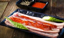 套新猪肉边用辣味番茄酱 免版税库存图片