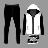套时髦人的衣裳 人燃烧物、裤子和运动鞋成套装备  库存照片