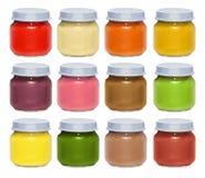 套明亮的多彩多姿的罐头用婴儿食品 免版税库存照片