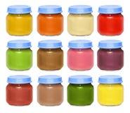 套明亮的多彩多姿的罐头用婴儿食品 库存照片