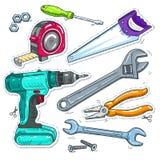 套木匠业工具、钻子、锯和卷尺 图库摄影