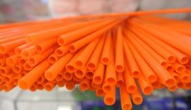 套橙色秸杆 库存图片
