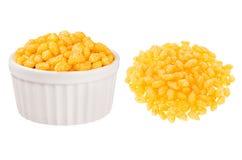 套橙色辣椒玉米黏附作为堆和在被隔绝的陶瓷碗在白色背景 免版税库存照片