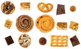 套甜点:小圆面包,曲奇饼,巧克力 隔离 库存照片