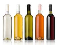 套白色、玫瑰和红葡萄酒瓶。 免版税库存照片