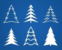 套白色圣诞节树 平的设计 免版税库存照片