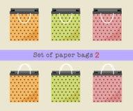 套纸袋2,桔子,绿色,桃红色圆点纸袋 也corel凹道例证向量 免版税库存照片