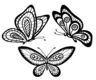 套美丽的黑白凸花花边蝴蝶 图库摄影