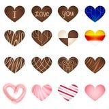 套艺术在心脏形状的牛奶巧克力 免版税库存照片
