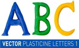 套英语字母表彩色塑泥信件 库存照片