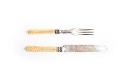 套葡萄酒餐具 刀子和叉子与骨头把柄在白色背景 顶视图 库存照片
