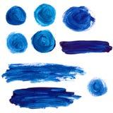 套蓝色丙烯酸漆污点和冲程 免版税库存照片