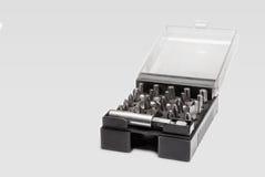 套螺丝在一个黑塑料盒打翻 免版税图库摄影