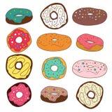 套逗人喜爱的五颜六色的油炸圈饼 免版税库存照片