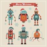 套逗人喜爱的减速火箭的葡萄酒行家圣诞节机器人 免版税库存图片