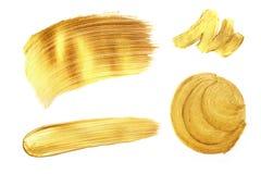 套金黄油漆冲程,隔绝在白色 免版税库存照片