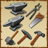 套铁砧、锯、锤子和其他工具 免版税图库摄影