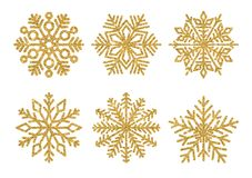 套闪烁金黄雪花 冬天元素 在白色背景的光亮的雪花 图库摄影