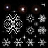 套雪花和光亮爆发 元素的汇集圣诞节的和冬天设计 库存图片