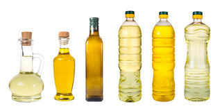 套额外处女橄榄油和向日葵种油在wh的瓶子 免版税库存图片