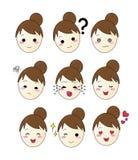 套9个情感女孩小圆面包面孔 免版税库存图片
