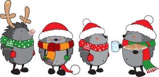 套4只逗人喜爱的猬为圣诞节穿戴了 免版税库存照片