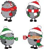 套4只逗人喜爱的猬为圣诞节穿戴了 库存图片