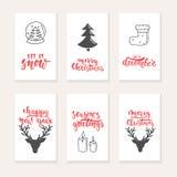 套6圣诞节和新年与手拉的刷子字法和剪影元素的贺卡 假日邀请 免版税库存图片