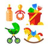 套婴孩辅助部件和玩具 免版税库存图片