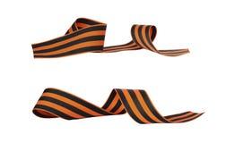 套5月的橙色和黑镶边丝带标志2月9日和23日 库存照片