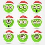套滑稽的绿色圣诞老人的elfs在凝视玻璃微笑 库存照片