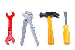套children& x27; 在白色backg隔绝的s玩具工具塑料颜色 免版税库存图片