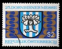 奥地利打印的邮票,展示Dornbirn公平的象征 免版税图库摄影