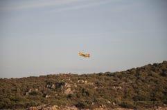 奥尔比亚撒丁岛Canader灭火 库存照片