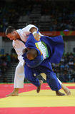 奥林匹克冠军捷克Judoka白色的卢克斯Krpalek在反对葡萄牙的豪尔赫丰塞卡湾的胜利以后 免版税库存照片
