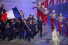 奥林匹克冠军马丁举着法国旗子的Fourcade带领奥林匹克队法国在2018个冬季奥运会打开期间 图库摄影