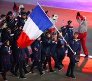 奥林匹克冠军马丁举着法国旗子的Fourcade带领奥林匹克队法国在2018个冬季奥运会打开期间 库存图片