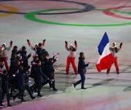 奥林匹克冠军马丁举着法国旗子的Fourcade带领奥林匹克队法国在2018个冬季奥运会打开期间 免版税库存照片