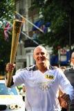 奥林匹克2012个火炬赛跑者 库存照片