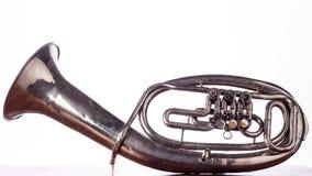 女低音在白色隔绝的saxhorn关闭 免版税库存图片