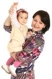 女儿愉快的矮小的母亲 免版税图库摄影