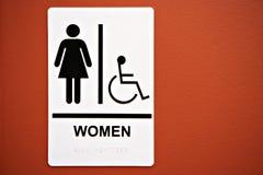 女厕所符号墙壁 免版税库存图片