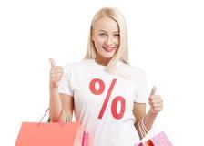 女售货员画象 有购物袋的秀丽妇女 免版税库存图片