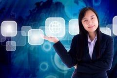 女商人…和您的手指是 在技术背景蓝色 图库摄影