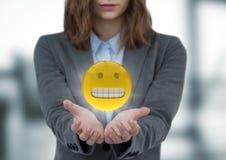 女商人与实施和与火光的emojis反对模糊的窗口 库存例证