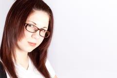 女商人佩带的眼镜的纵向 免版税图库摄影