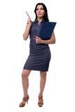 女商人充分的身体画象有想法在有剪贴板和笔的礼服,隔绝在白色 库存图片