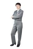 在灰色诉讼打扮的女商人 库存图片