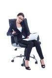 年轻女商人坐椅子,与膝上型计算机和t一起使用 图库摄影