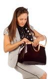 女商人搜索某事在袋子 免版税库存照片
